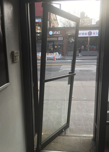 Broken store-front Door shutter repair New York : door broken - pezcame.com